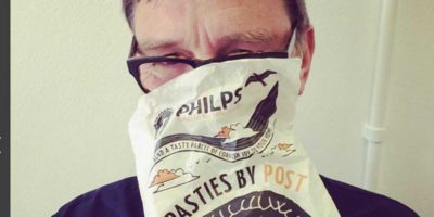 Peter eating pasties in St Ives, whilst on a self catering holiday.