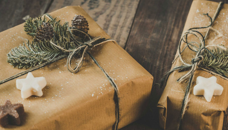 wrapped christmas presents on wooden table