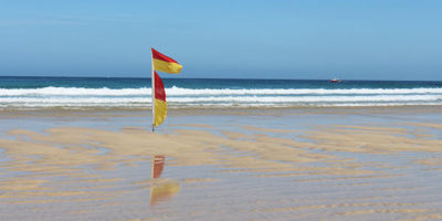 Beach flags in St Ives